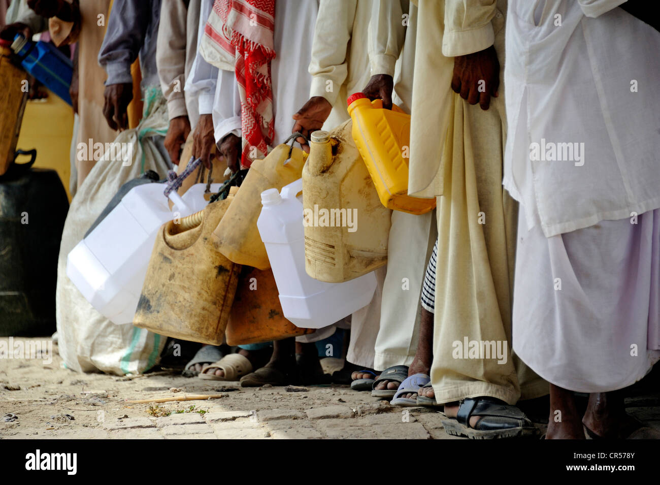 Charity organisation distributing fuel to power diesel pumps which are used to help fill the irrigation channels - Stock Image