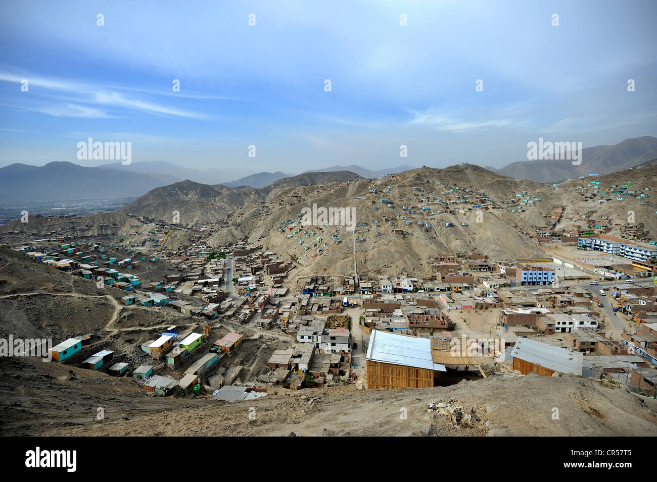 Houses built on sandy slopes in the dry desert climate, slums of Amauta, Lima, Peru, South America Stock Photo