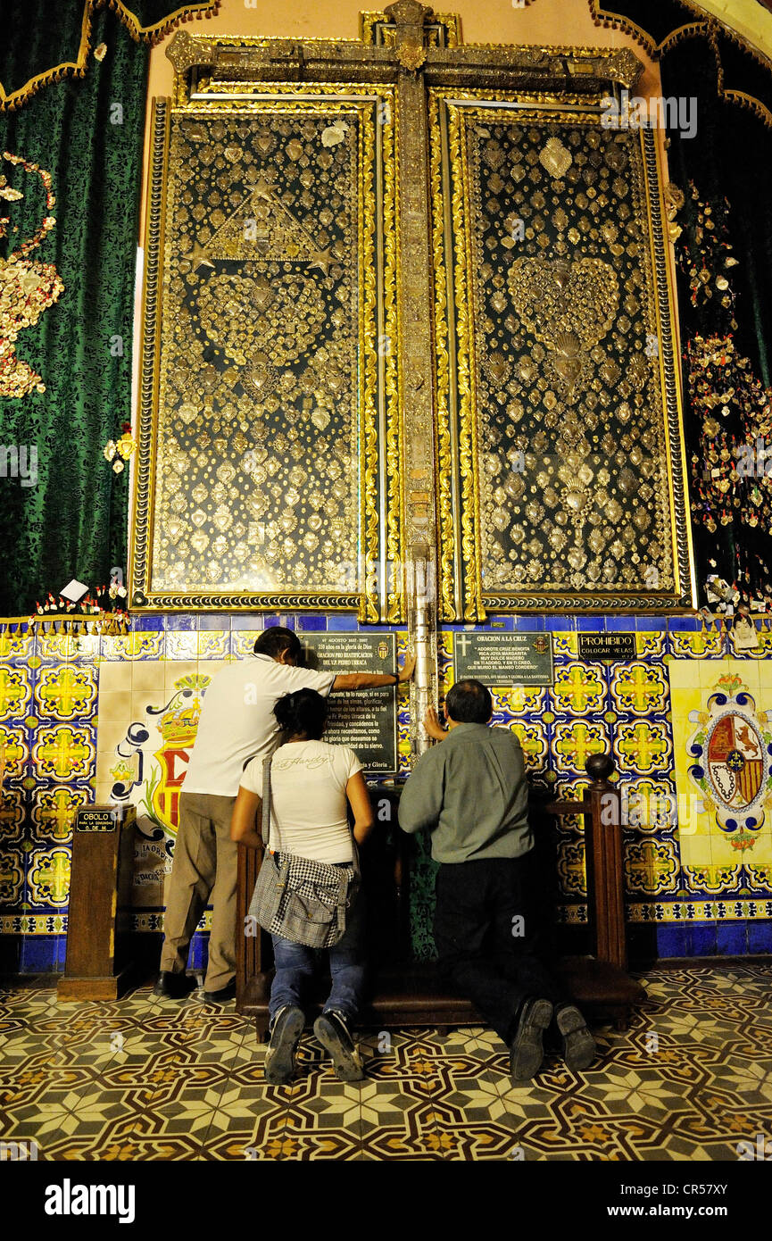 Believers praying for the recovery of family members, votive tablets, Iglesia de la Merced church, Lima - Stock Image