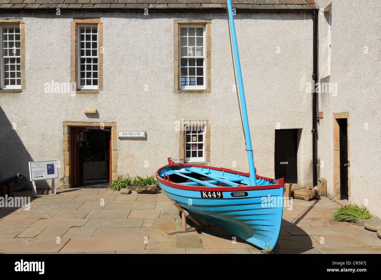 Boat by the front entrance to Orkney Museum in Tankerness House, Broad Street, Kirkwall, Orkney Islands, Scotland, - Stock Image