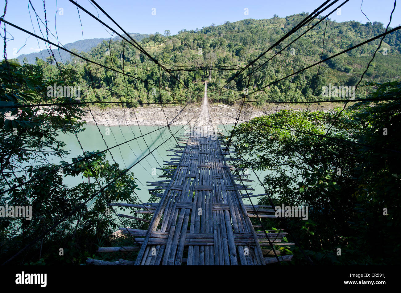 A 300 m long hanging bridge crosses the mighty river Siang in the hills of Arunachal Pradesh, , India, Asia - Stock Image