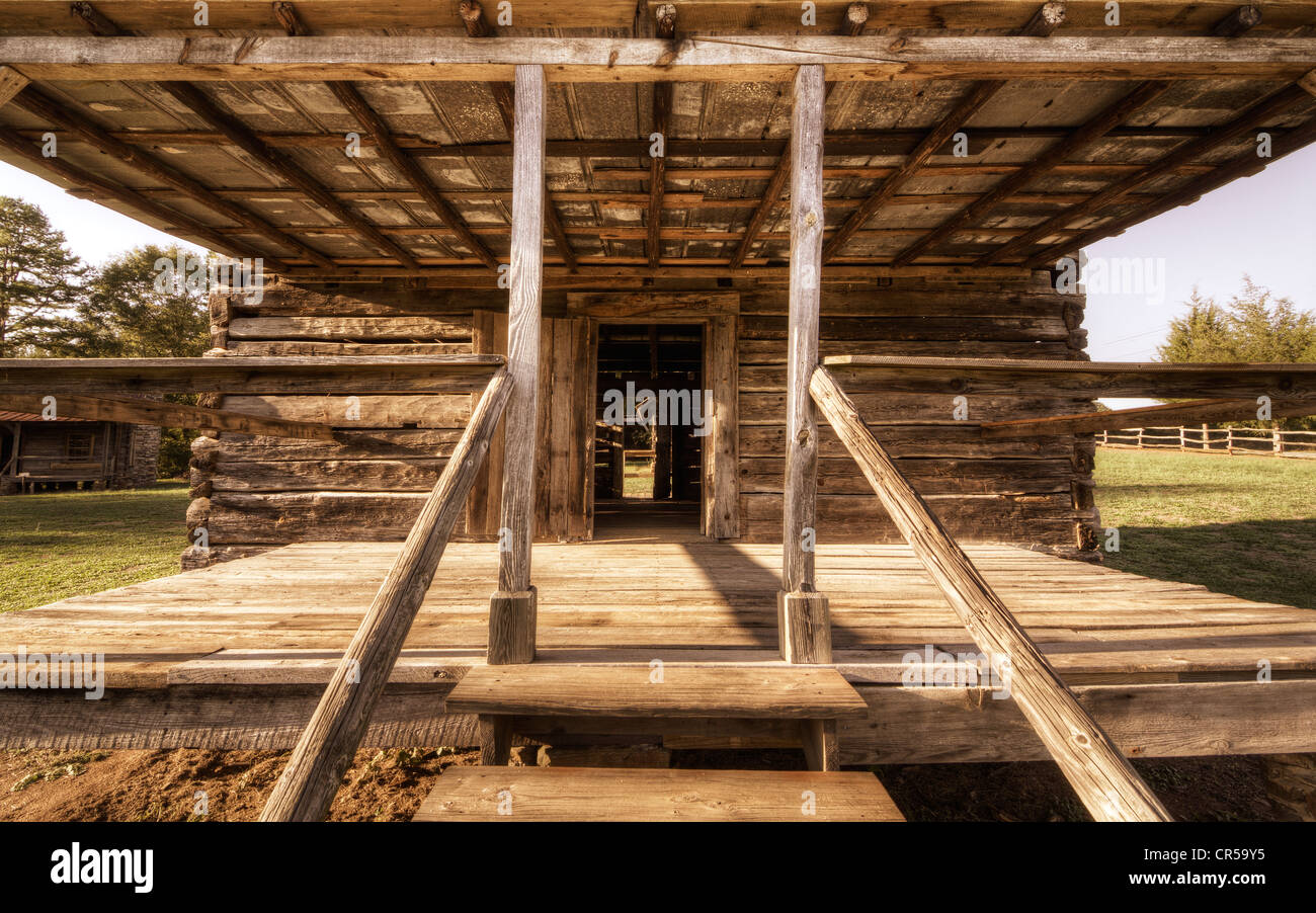 porch of an old wood log cabin Stock Photo