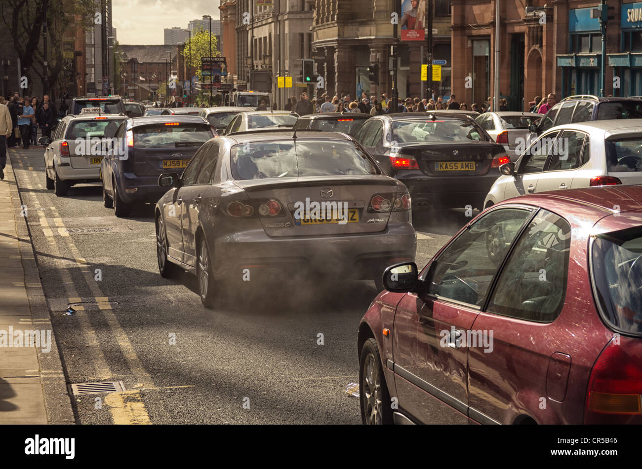Traffic chaos in Manchester on the day that Manchester City football club paraded to celebrate their win of the - Stock Image