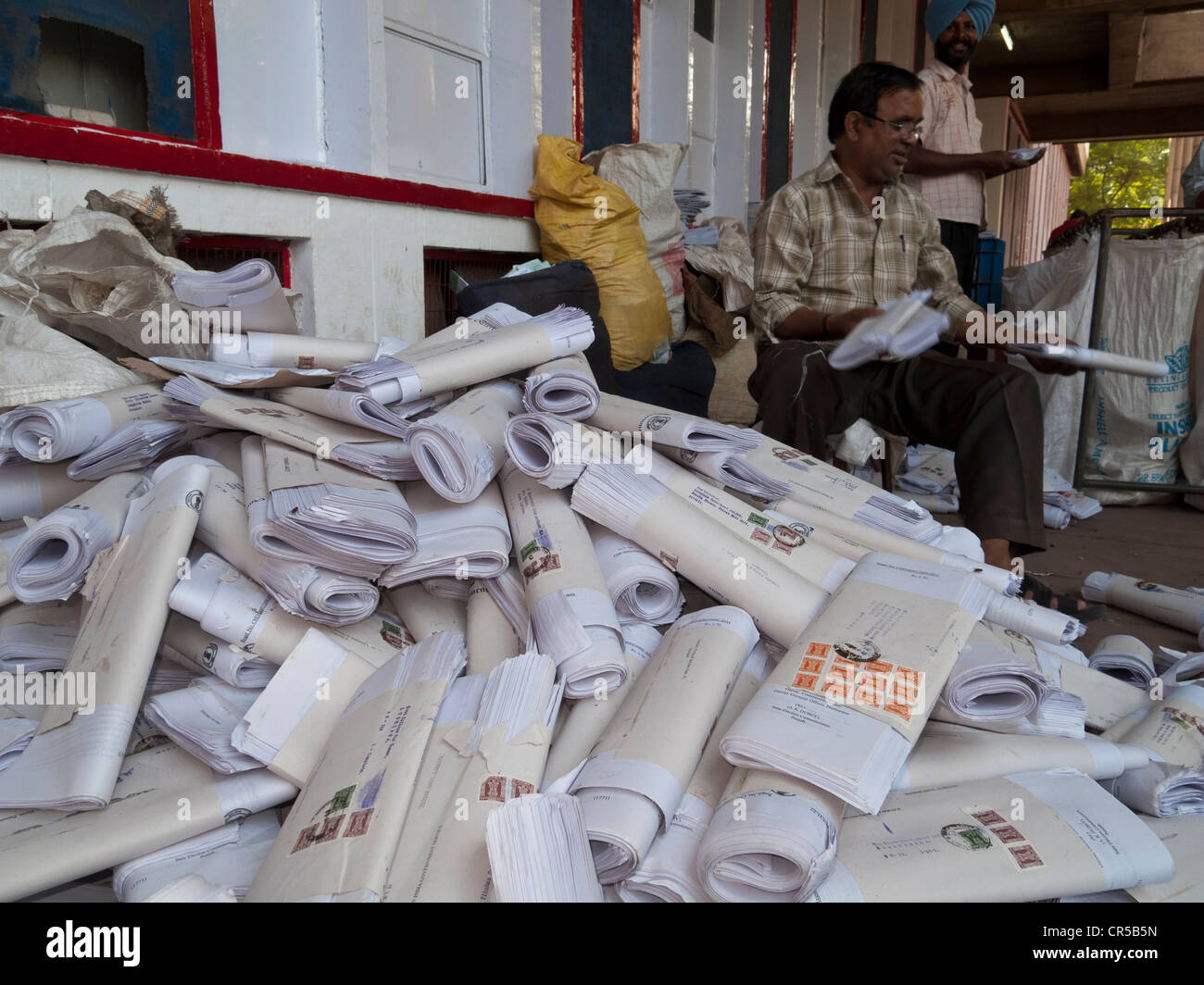 Employee sorting letters in front of the main post office in the capital of Himachal Pradesh, Chandigarh, India, Stock Photo