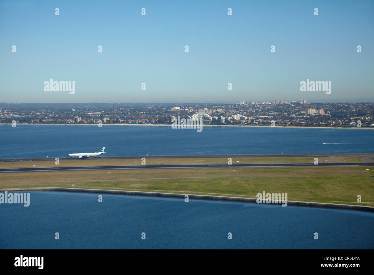 Plane landing at Sydney Airport, and Botany Bay, Sydney, New South Wales, Australia - aerial Stock Photo