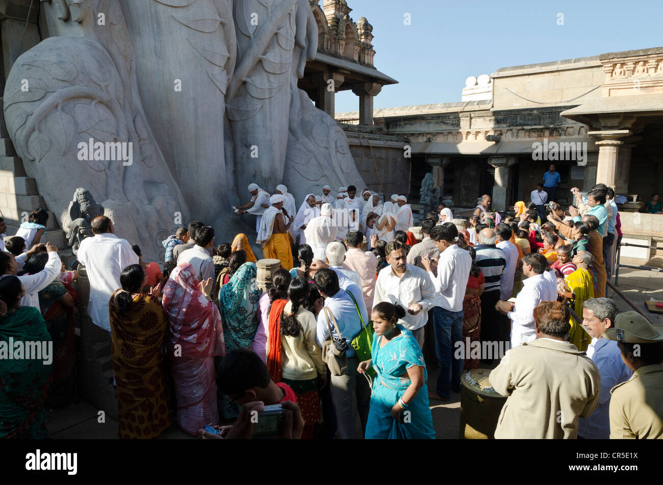 Pilgrims on Indragiri hill in Sravanabelagola to receive the blessings of Bahubali by the local priests, Karnataka, - Stock Image