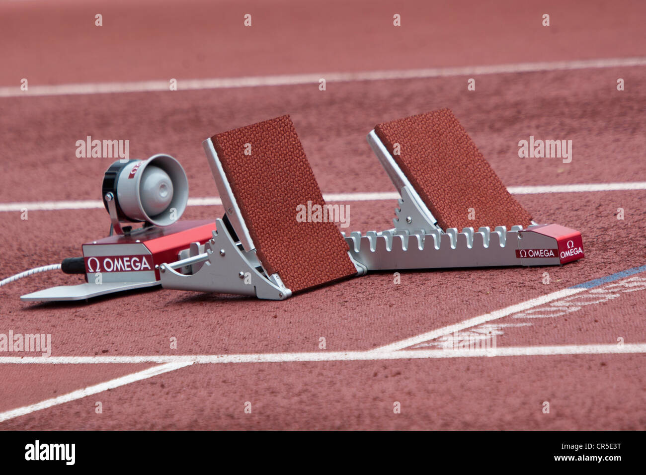 Empty track and field starting blocks. - Stock Image