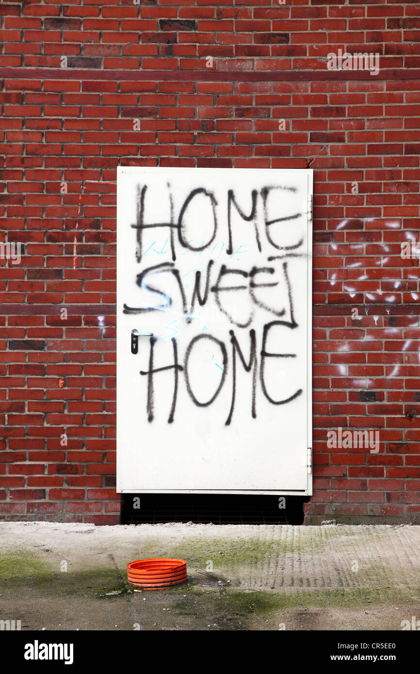 Graffiti 'Home Sweet Home' on a condemned building door of an old industrial building. Herten, North Rhine - Stock Image