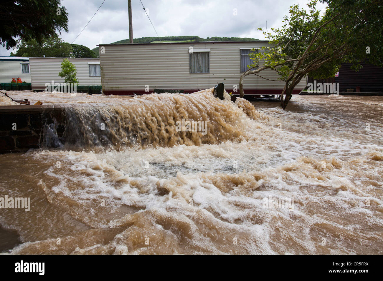 Floodwater flowing through a campsite near Aberystwyth, Wales, UK - Stock Image