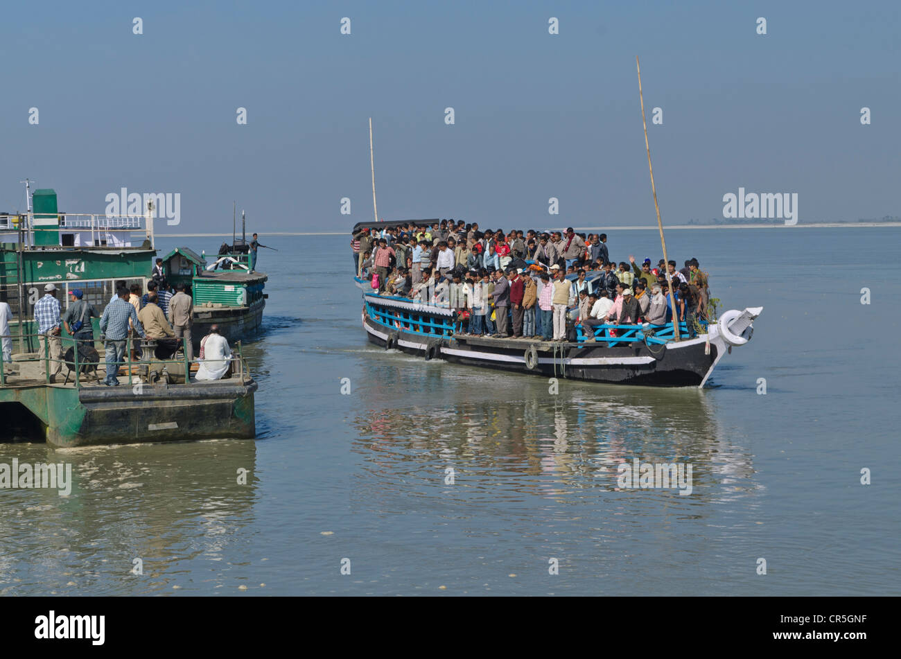 Rustic ferry-boats at Jorhat take more than one hour to cross the mighty Brahmaputra River, India, Asia - Stock Image