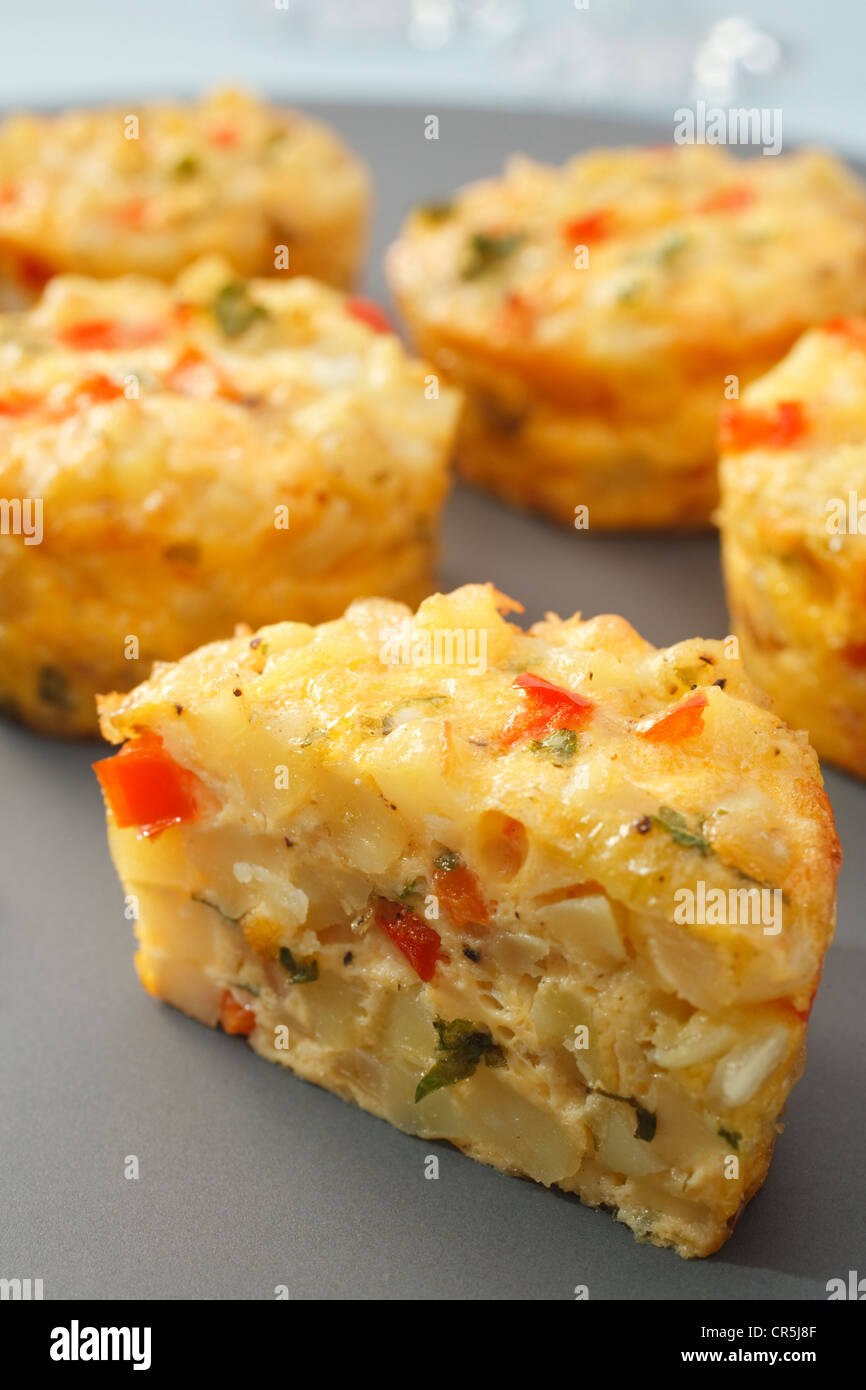 Mini frittata with potato and red capsicum, delicious finger food. - Stock Image