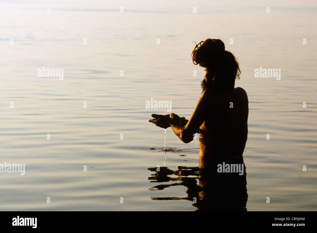 Sadhu During Hindu Morning Prayer Stock Photos & Sadhu
