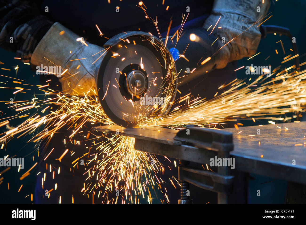 Cutting a steel plate with an angle grinder Stock Photo