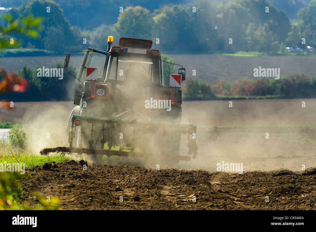 Farmer with a tractor during field work in autumn, Grevenbroich, North Rhine-Westphalia, Germany, Europe - Stock Image