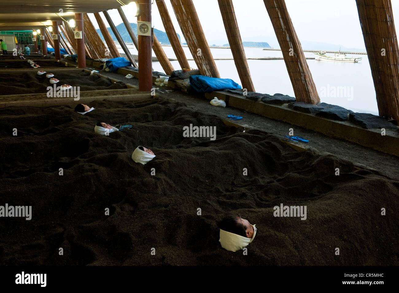 Japan, Kyushu Island, city of Ibusuki, bath of hot sand on the beach of the Ibusuki Sunamushi Onsen - Stock Image