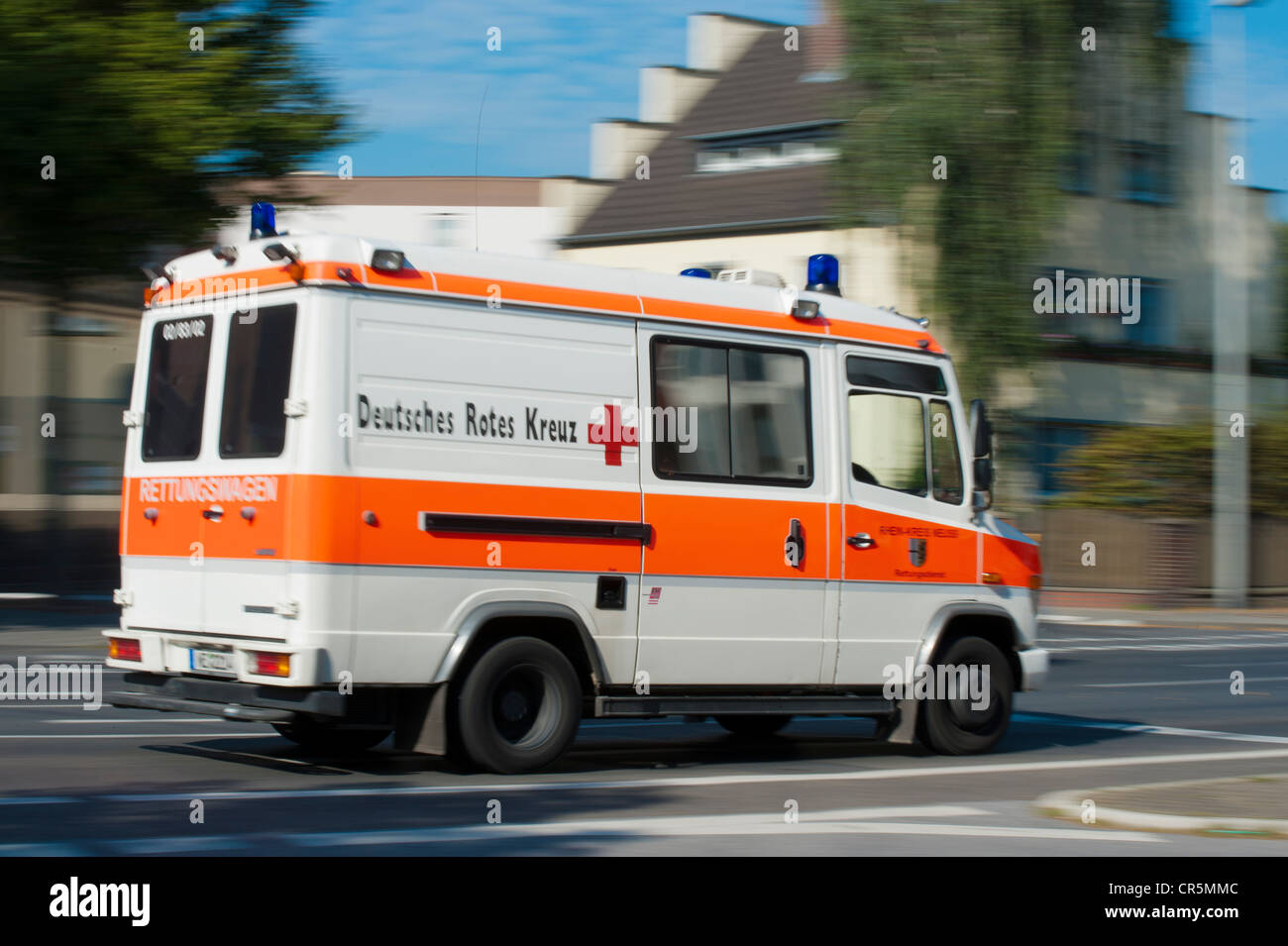 Deutsches Rotes Kreuz, German Red Cross, ambulance on an emergency call, Grevenbroich, North Rhine-Westphalia, Germany, - Stock Image