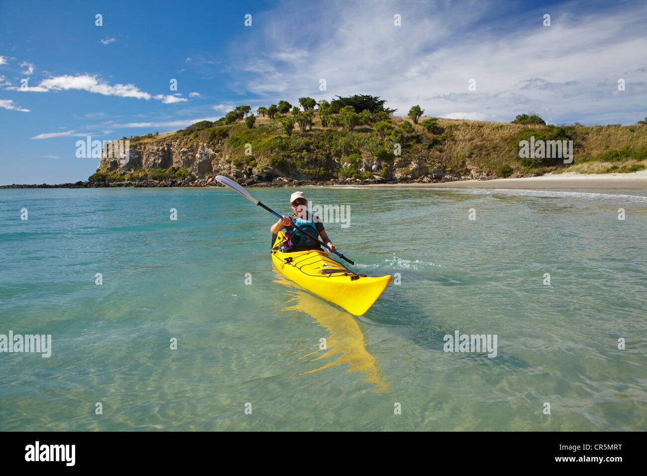Sea kayak by beach near Doctors Point, and Mapoutahi Pa, Historic Maori Pa Site, north of Dunedin, South Island, Stock Photo