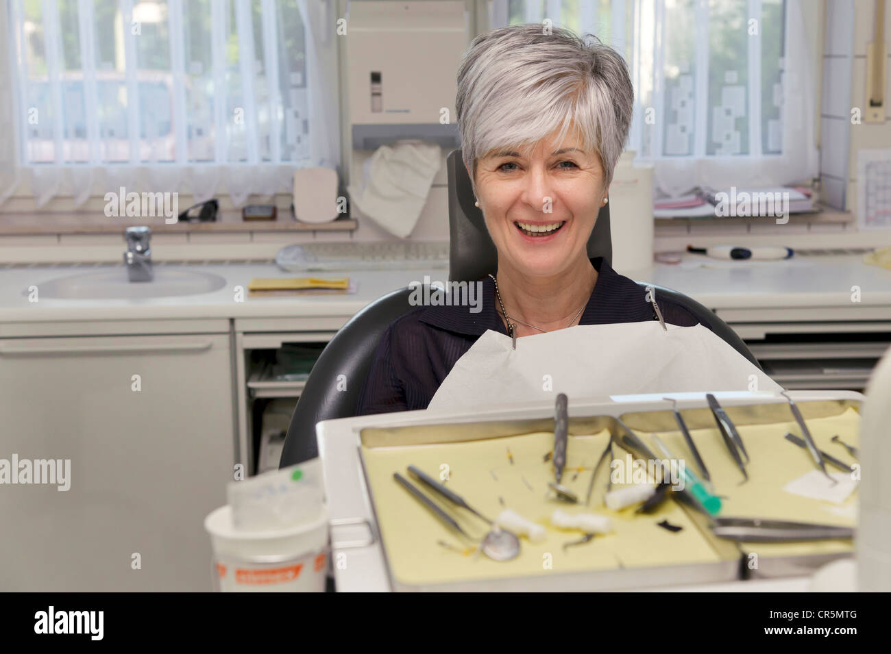 Happy patient of a dentist - Stock Image