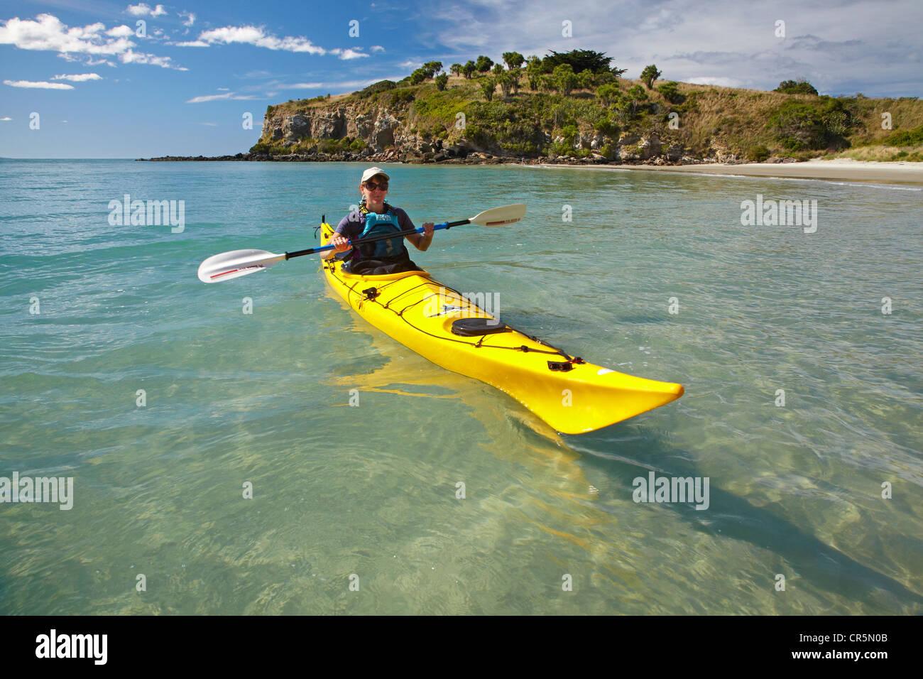 Sea kayak by beach near Doctors Point, and Mapoutahi Pa, Historic Maori Pa Site, north of Dunedin, South Island, Stock Photo