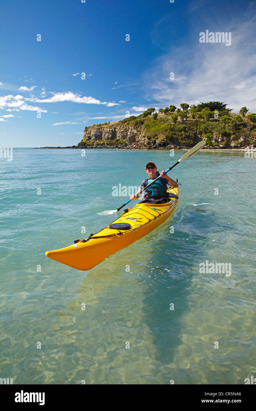Sea kayak by beach near Doctors Point, and Mapoutahi Pa, Historic Maori Pa Site, north of Dunedin, South Island, - Stock Image