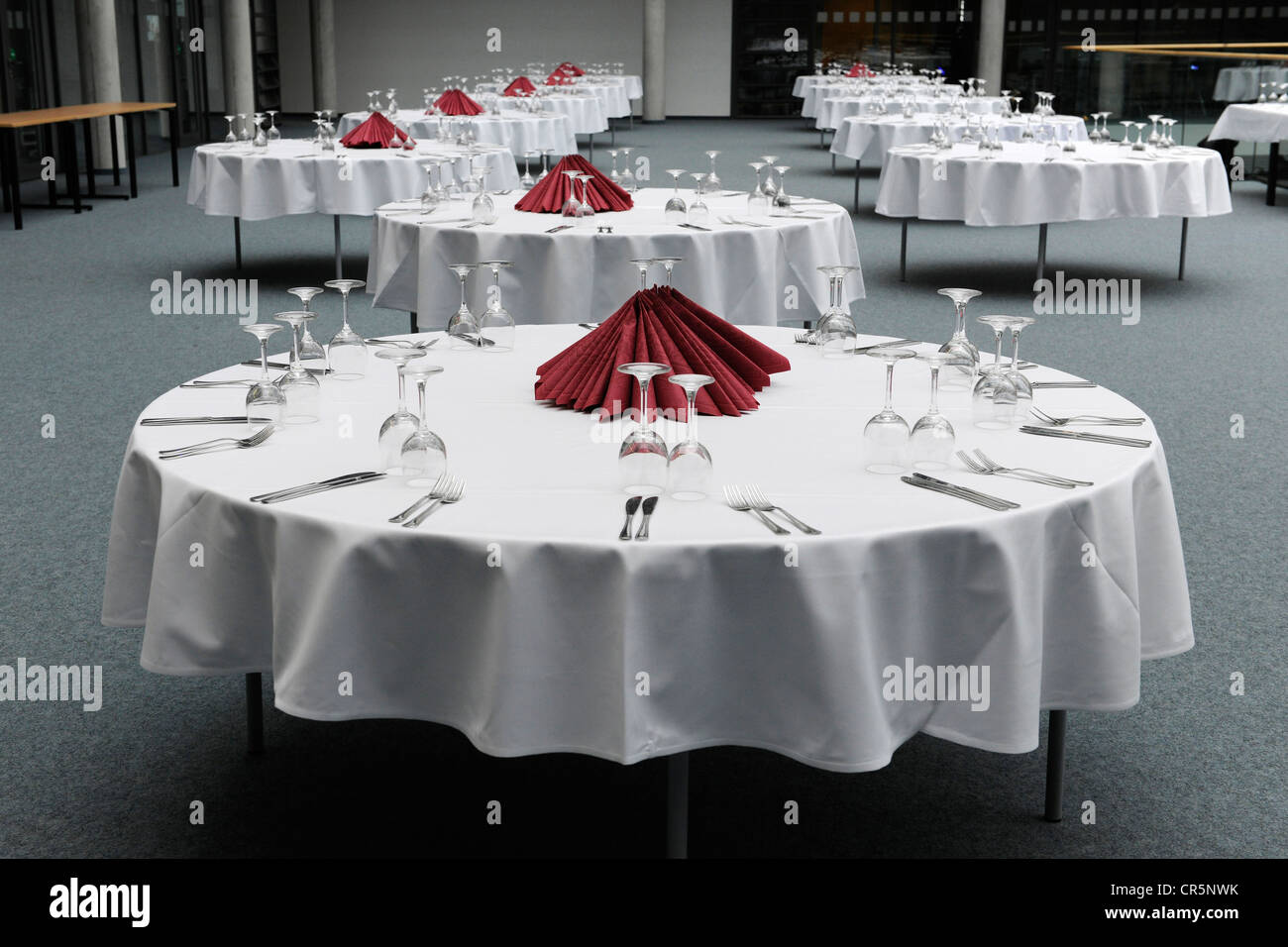 Corporate event, preparations, dining tables are laid with crockery, cutlerly and glasses, Thuringia, Germany, Europe - Stock Image