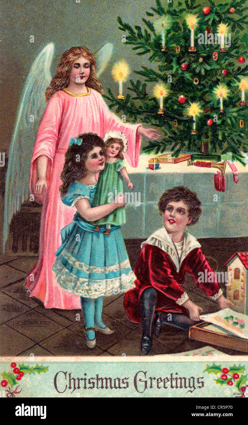 Christmas Greetings - vintage Christmas card with Angel and children - Stock Image