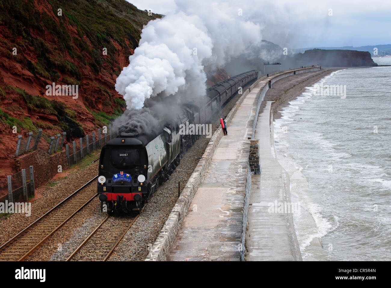 The Great Britain V double headed by 34067 Tangmere and 70013 Oliver Cromwell en route to Penzance via Sea Wall - Stock Image