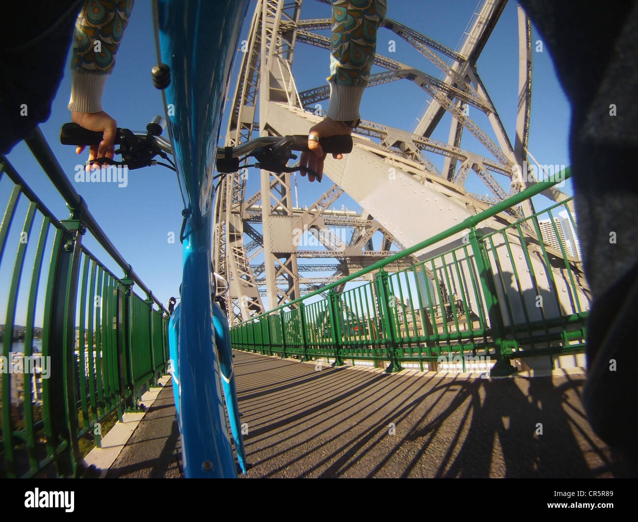 Cyclist crossing Story Bridge towards Kangaoo Point, Brisbane, Queensland, Australia. MR - Stock Image