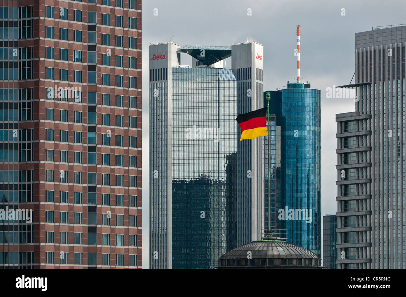 German flag flying on the dome of Festhalle Frankfurt, festival hall, Frankfurt trade fair grounds, in front of Stock Photo
