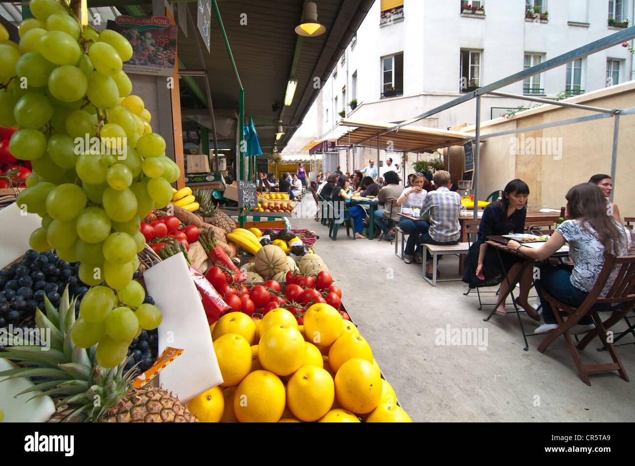 France, Paris, the Marais District, Marche des Enfants Rouges, fruits stand and cafe terrace Stock Photo