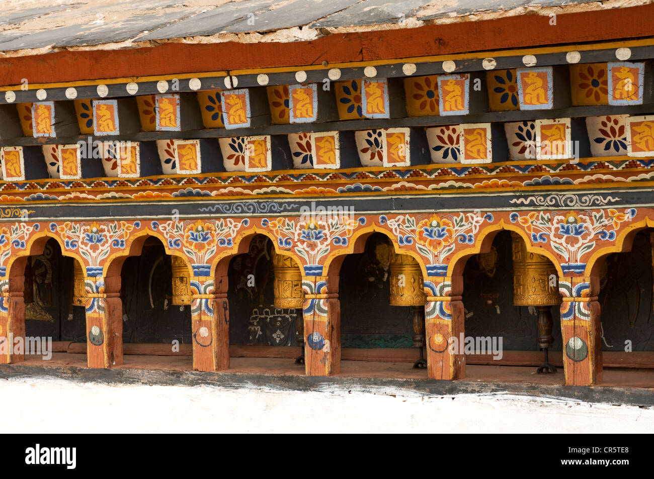 Buddhist prayer wheels in the Chimi Lhakhang fertility temple, Lobesa, Bhutan, South Asia - Stock Image