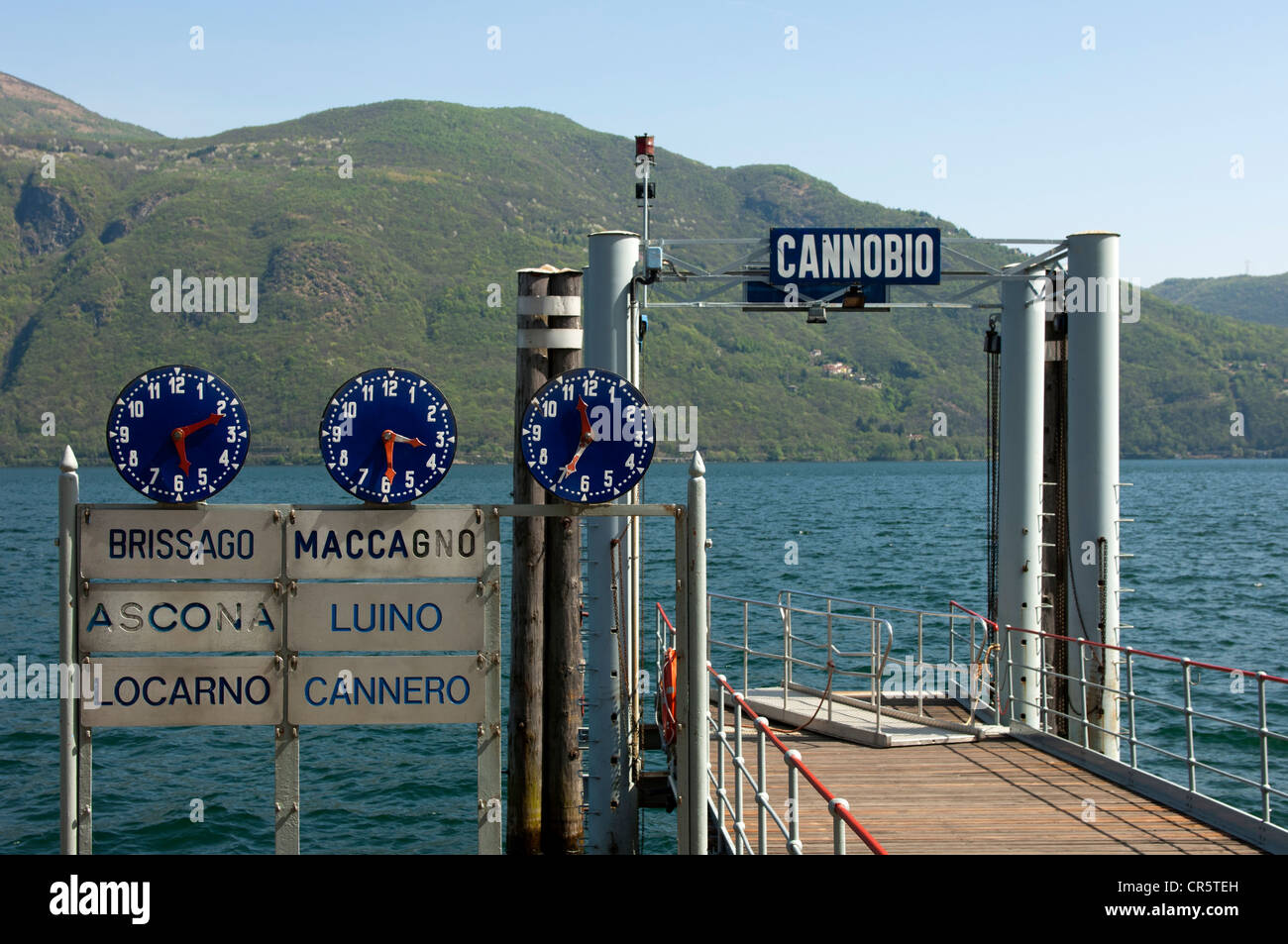 Clocks displaying departure times at the Cannobio jetty on Lake Maggiore, Piedmont, Italy, Europe - Stock Image