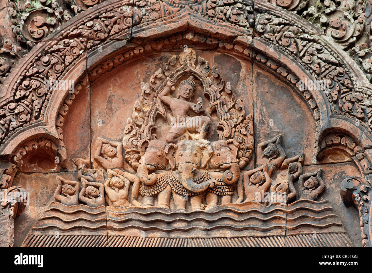 Indra, god of the sky, riding a chariot drawn by a three-headed elephant, part of the bas-reliefs of the east-facing - Stock Image