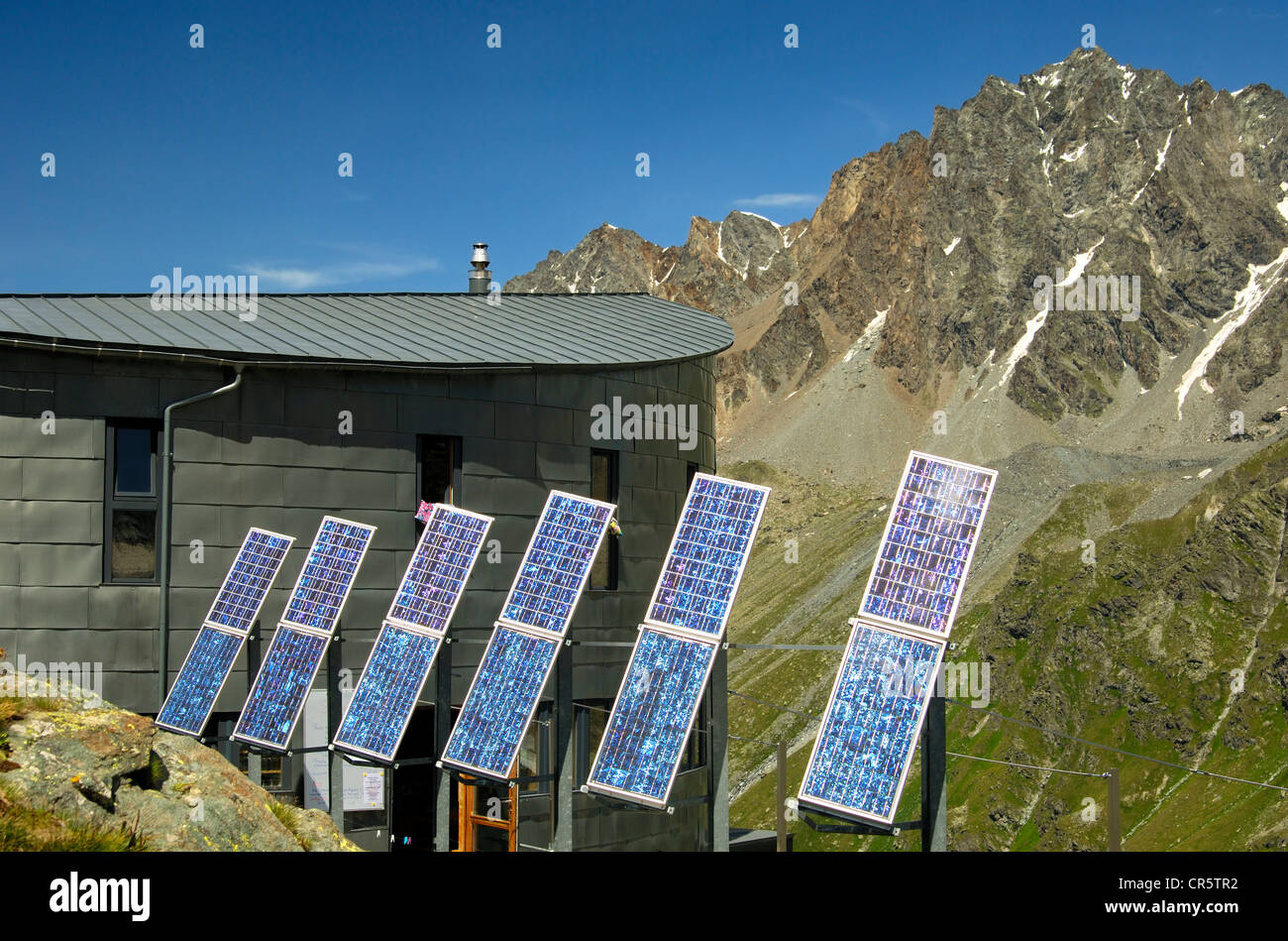 The futuristic Velan Hut, Cabane du Velan, of the Swiss Alpine Club, SAC, with its six solar panels in front of Stock Photo
