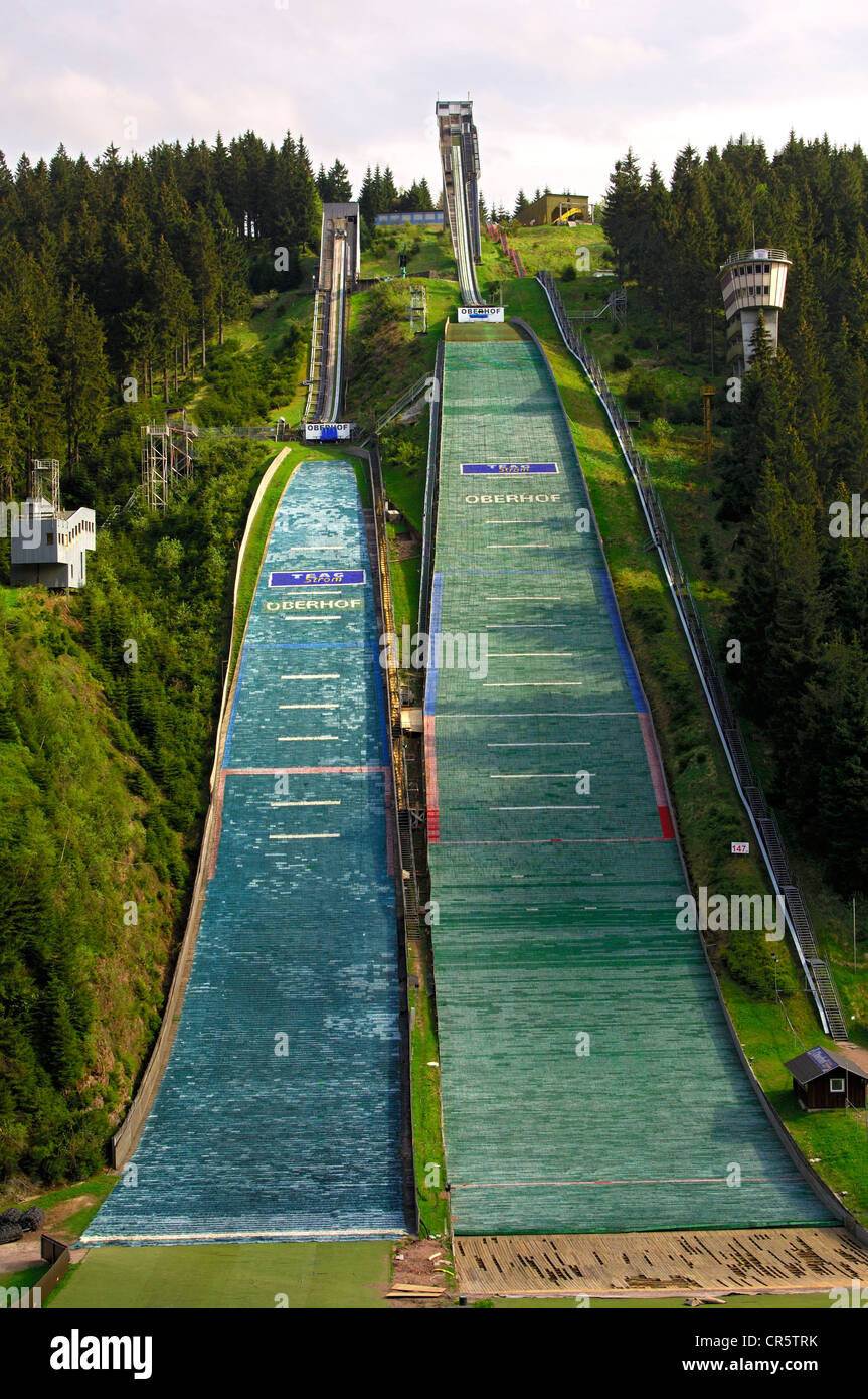 Normal and large ski flying hill, covered with jump mats, Am Kanzlersgrund ski jump complex in summer, near Oberhof, - Stock Image