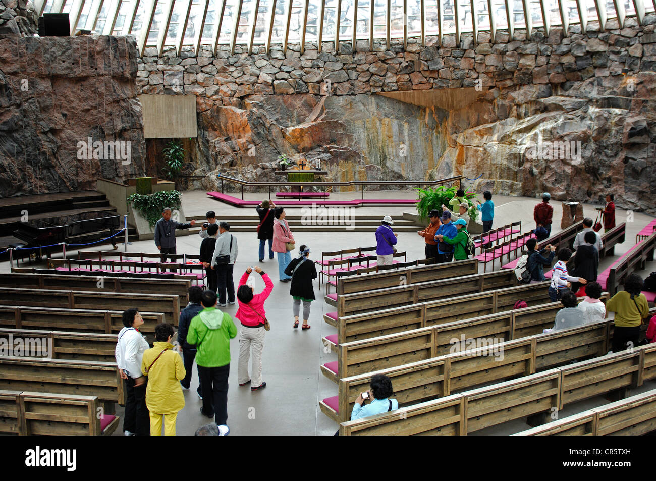 Asian tourists in the sanctuary of the Temppeliaukio Church in Helsinki, Finland, Europe Stock Photo