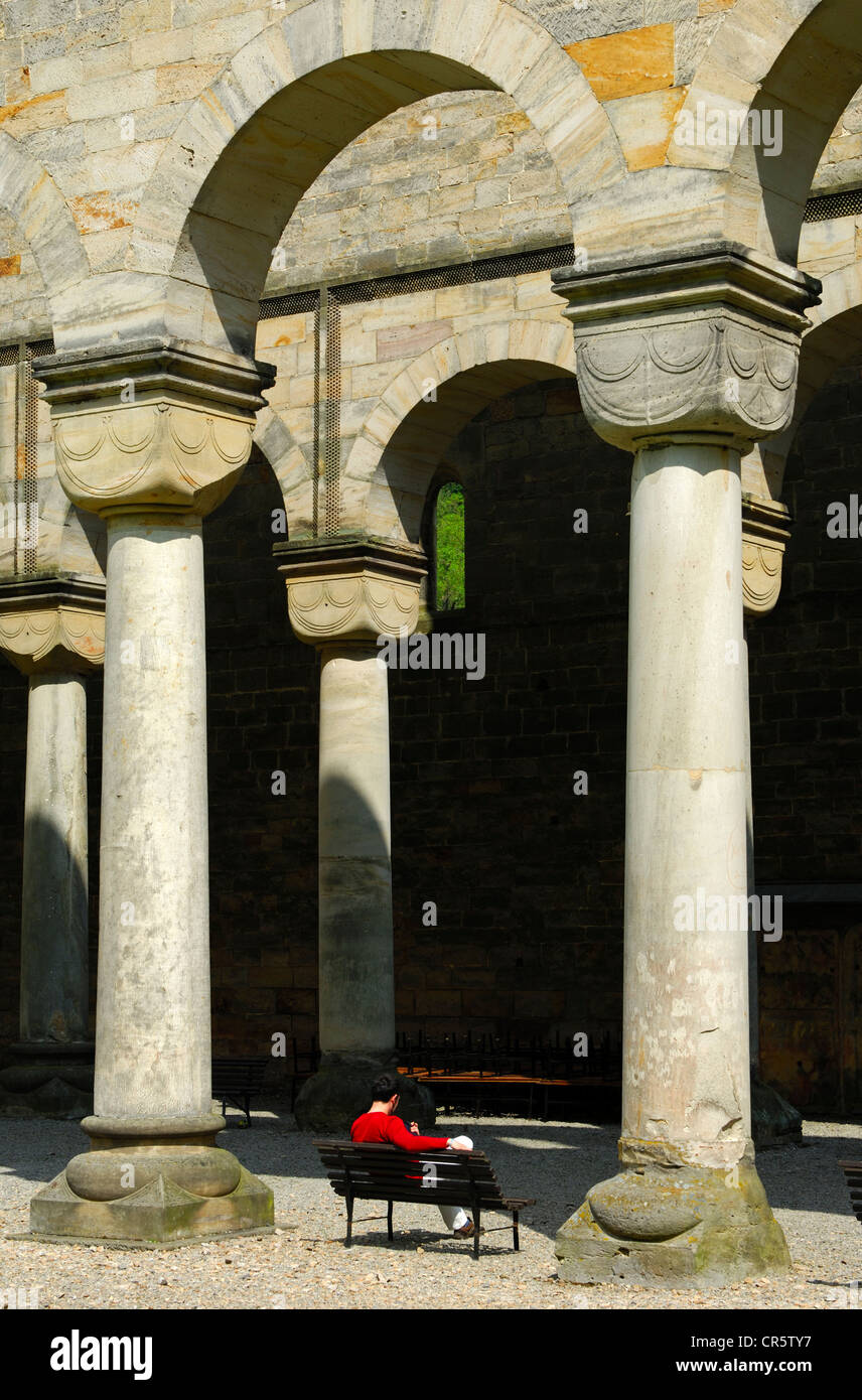 Visitors on the porch with round Romanesque columns, ruins of the Paulinzella Benedictine Monastery, Rottenbachtal, - Stock Image