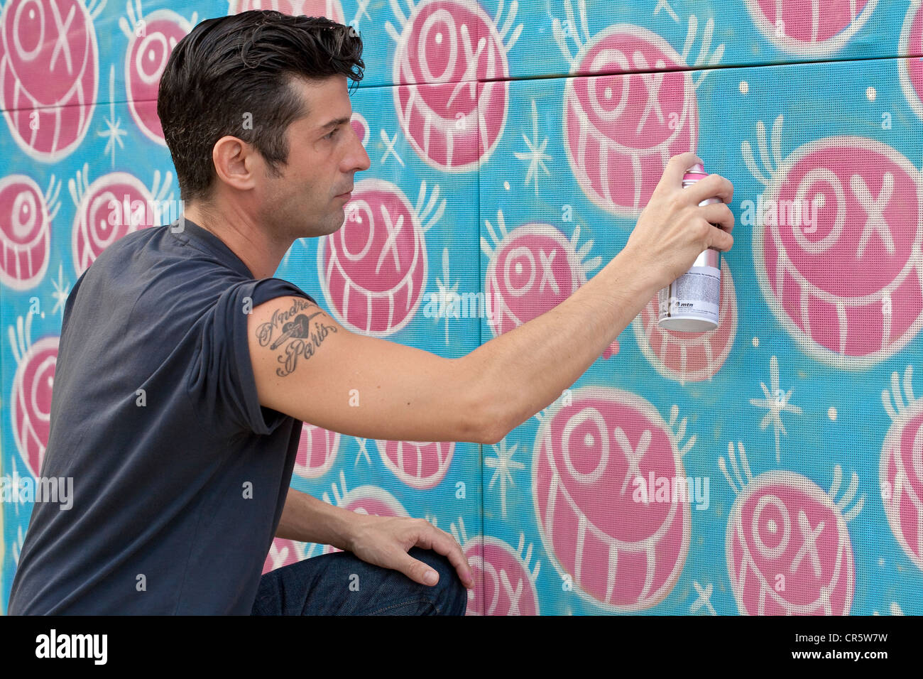 United States, Florida, Miami, Design District, tag artist Andre in action and his recuring character Mister A - Stock Image