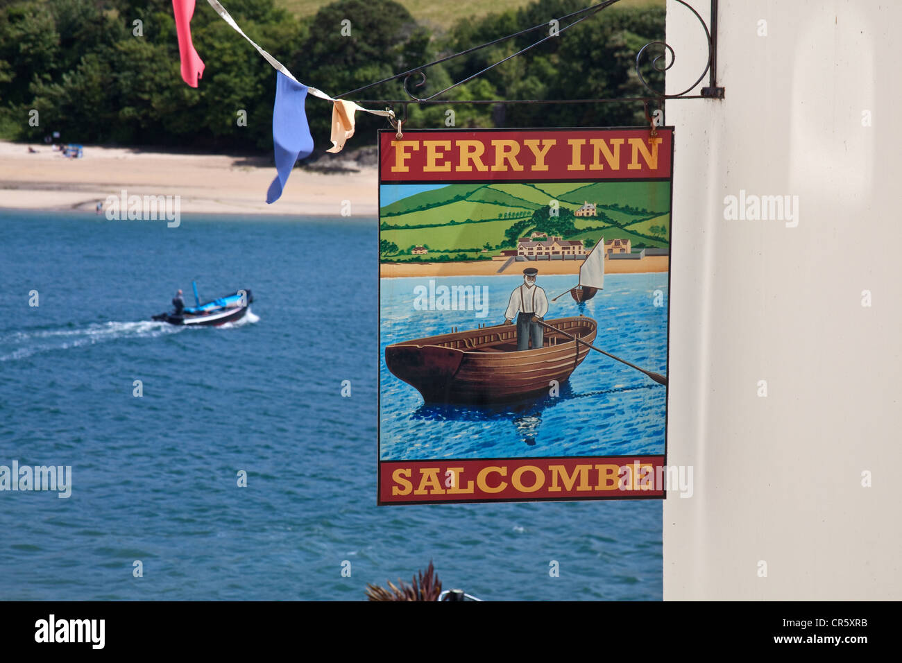 The Ferry Boat inn with the ferry or water taxi  in the background.Salcombe, Devon, England, United Kingdom. - Stock Image