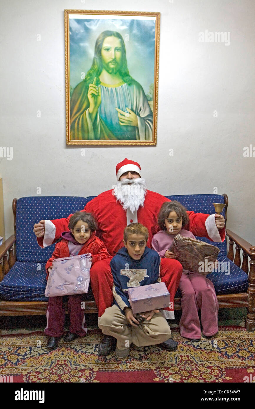 jordan amman arabic greek orthodox church santa claus delivering christmas gifts to the