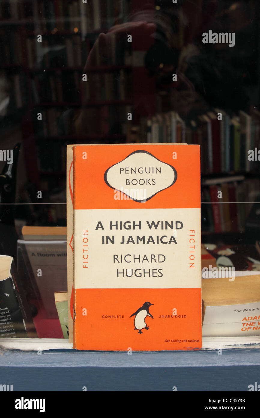Hay on Wye bookshop old orange Penguin paperback book cover in second hand book shop window in Hay on Wye Powys - Stock Image