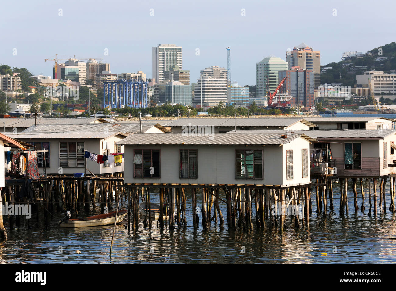 Houses on stilts, skyline of Port Moresby, Capital of Papua New Guinea - Stock Image