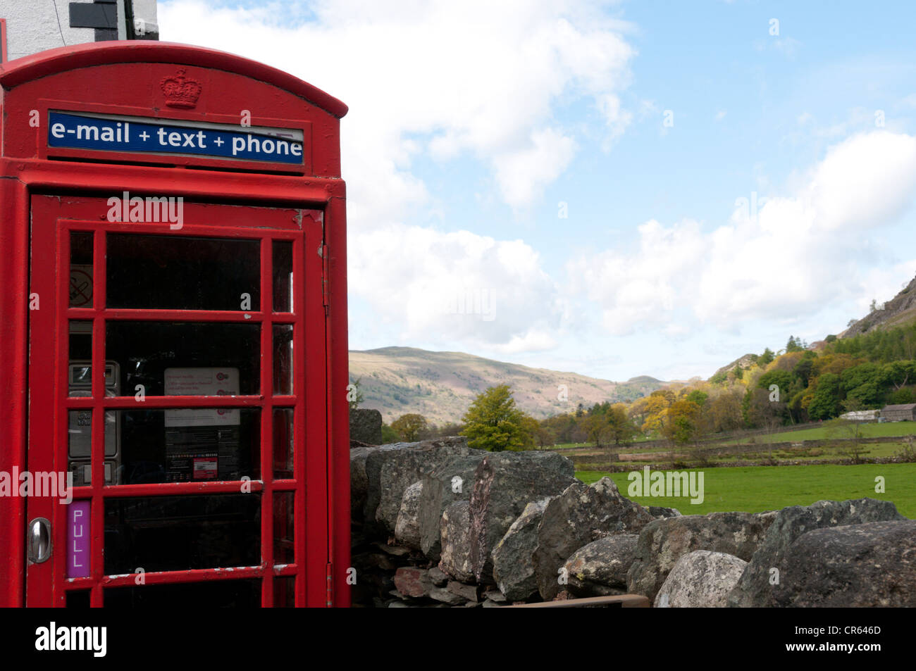 A red telephone box offering e-mail and text facilities in the Lake District village of Patterdale. - Stock Image
