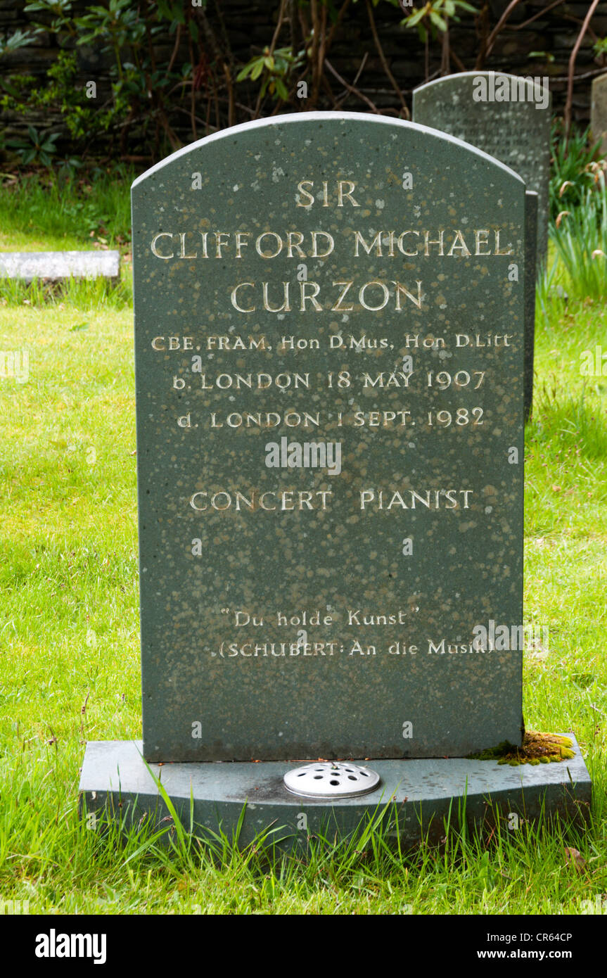 The gravestone of the concert pianist, Sir Clifford Michael Curzon, in the churchyard of St Patrick's church, Patterdale. Stock Photo
