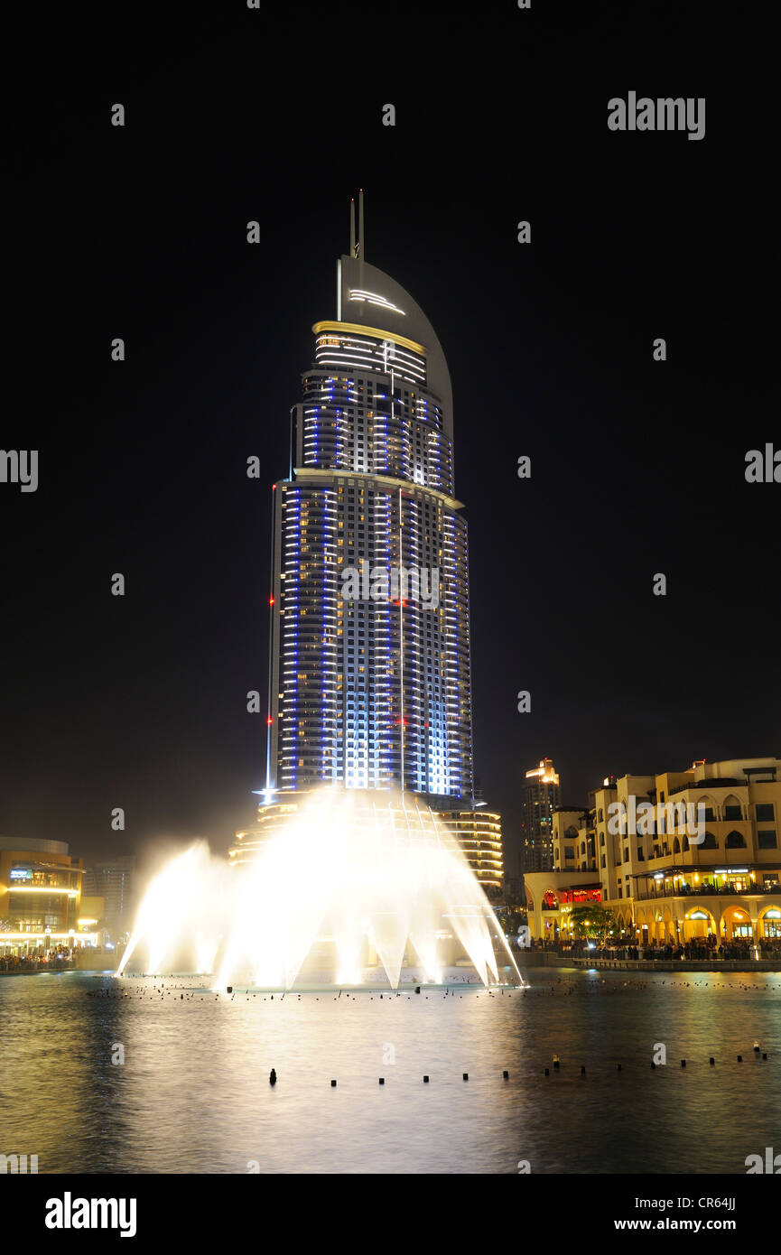 THE ADDRESS luxury hotel, 63 floors, at night,  Fountain outside the  Mall, Downtown , Business Bay, , United Arab - Stock Image