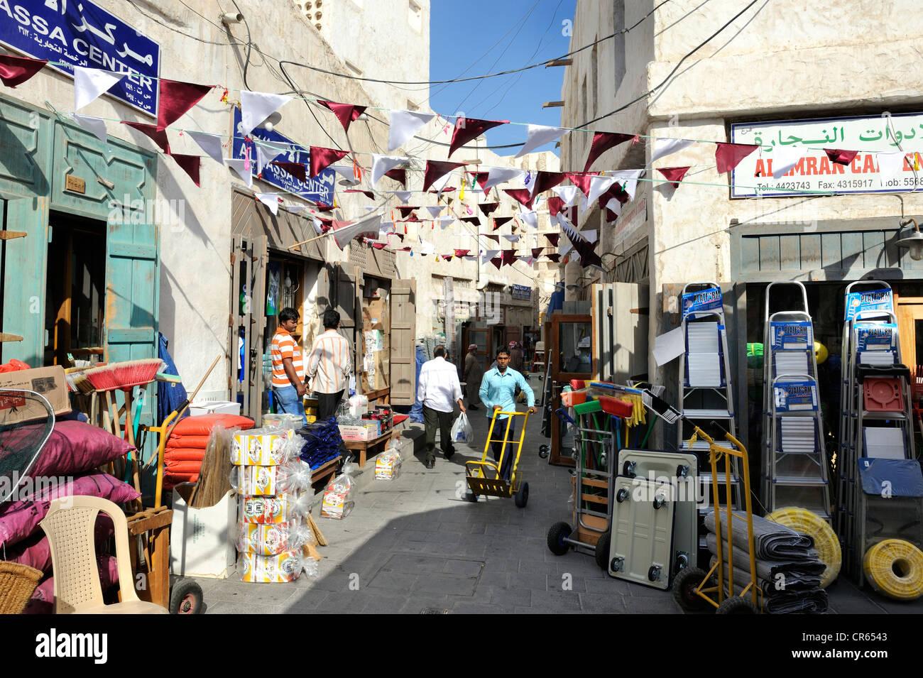 Merchants in Souq al Waqif, the oldest souq or bazaar in the country, , Qatar, Arabian Peninsula, Persian Gulf, - Stock Image