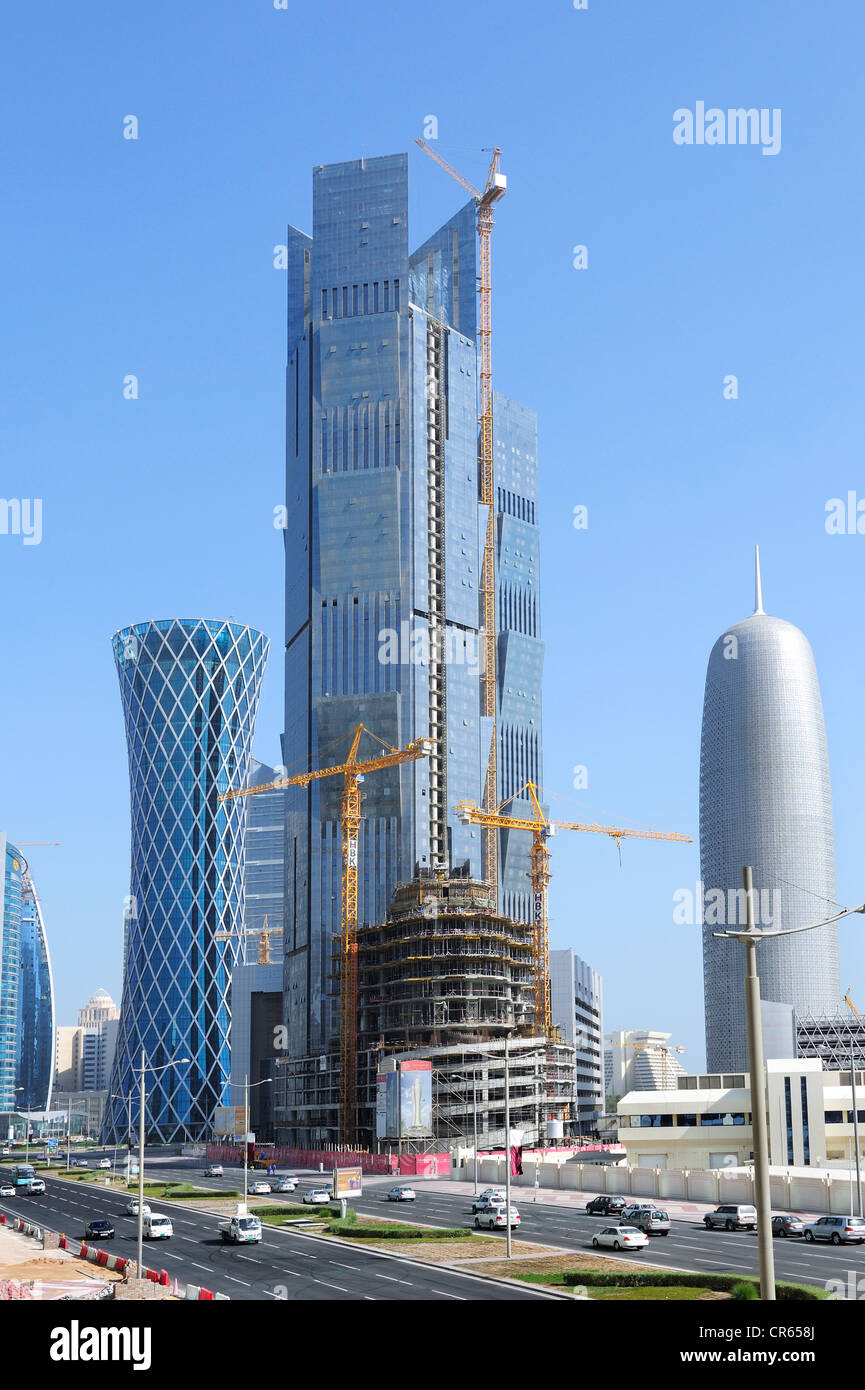 Construction work on Palm Tower at Majlis Al Taawon Street, Doha, Qatar, Arabian Peninsula, Persian Gulf, Middle - Stock Image