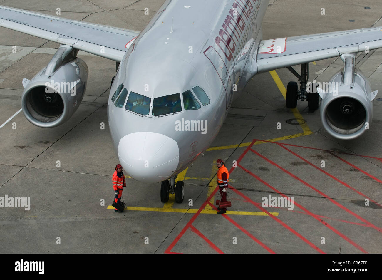 Germanwings aircraft, finishing touches prior to take-off, apron workers at the machine, Cologne Bonn Airport, also - Stock Image