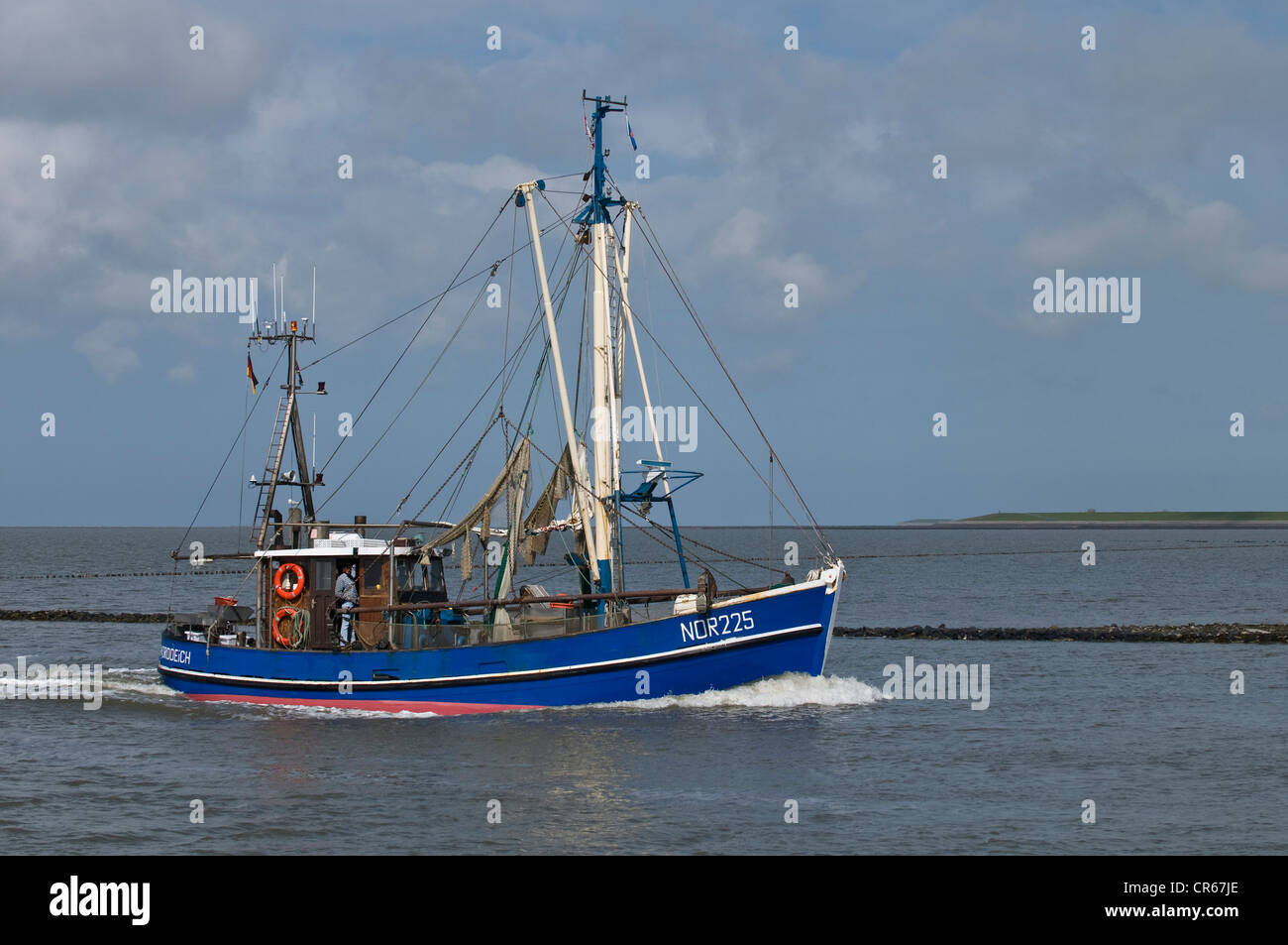 Blue crab fishing boat, NOR 225, returning to the port of Norddeich after fishing, Lower Saxon Wadden Sea - Stock Image