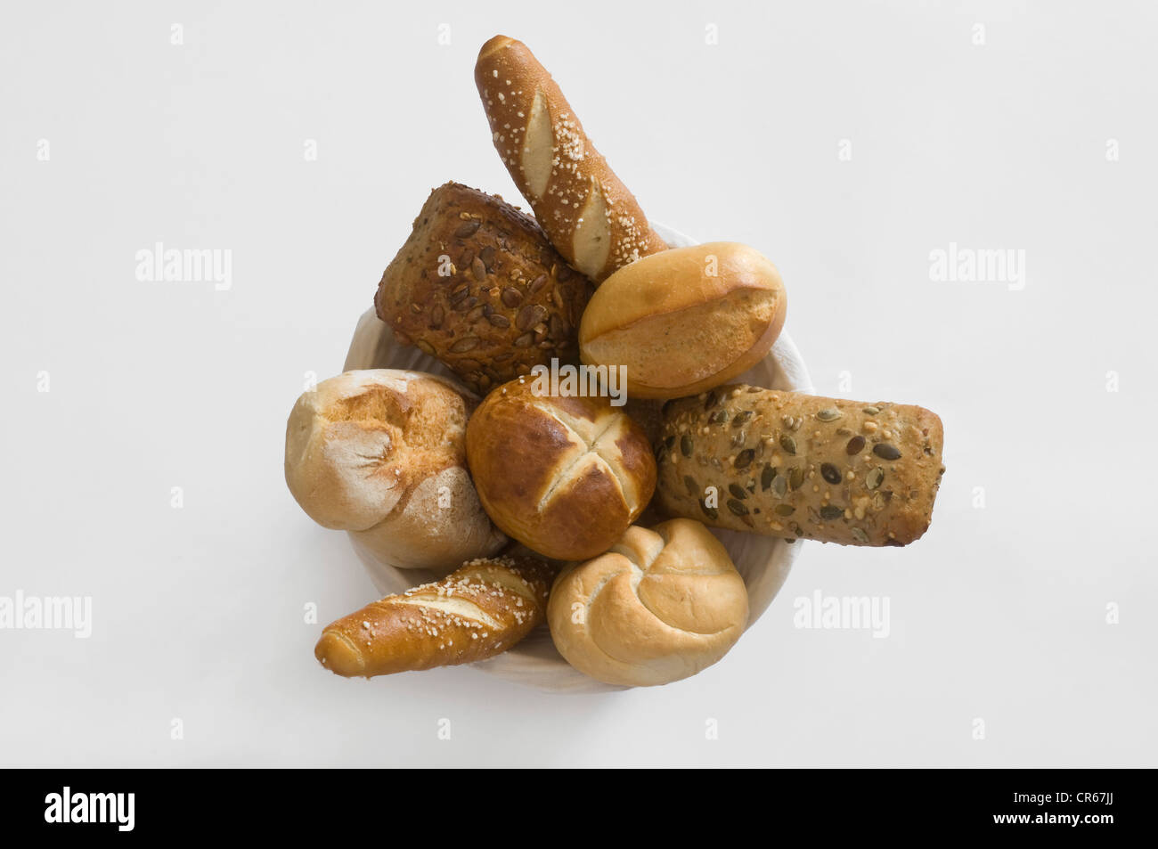 Basket with different kinds of rolls and pretzel varieties, breakfast rolls - Stock Image